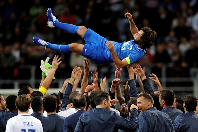Former Italian soccer player Andrea Pirlo is lifted up at the end of his farewell soccer match at the San Siro stadium in Milan, Italy, May 21, 2018. REUTERS/Daniele Mascolo