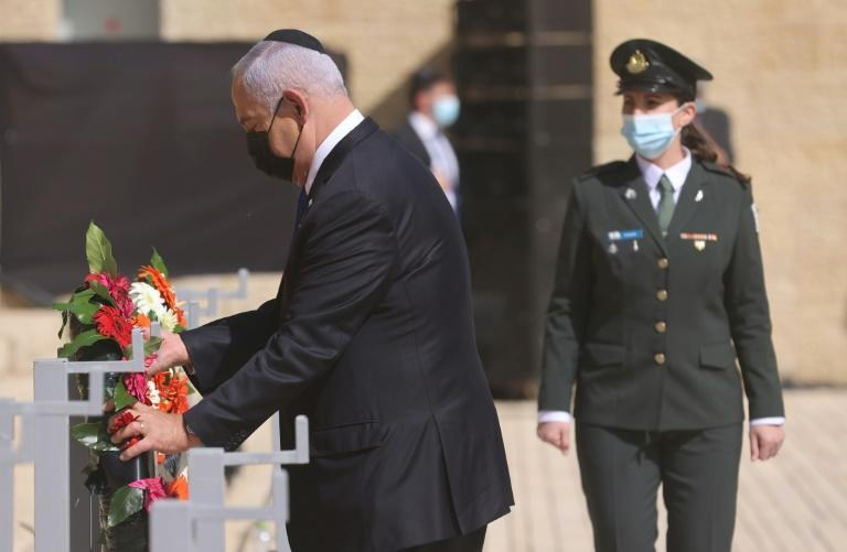 Israeli Prime Minister Benjamin Netanyahu attends a wreath-laying ceremony marking the Holocaust Remembrance Day at Warsaw Ghetto Square in Jerusalem's Yad Vashem memorial