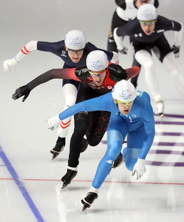 Speed Skating - Pyeongchang 2018 Winter Olympics - Men's Mass Start semifinal - Gangneung Oval - Gangneung, South Korea - February 24, 2018 - Andrea Giovannini of Italy, Olivier Jean of Canada and Linus Heidegger of Austria compete. REUTERS/Lucy Nicholson