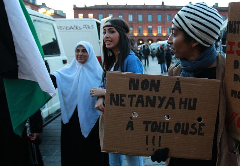 "A French demonstrator holds a placard that reads: ""No Netanyahu in Toulouse"" as another hold a Palestine flag during a demonstration in Toulouse, southwestern France, Wednesday, Oct. 31, 2012. Israeli Prime Minister Benjamin Netanyahu is visiting France on Wednesday and Thursday and will pay homage to a rabbi and three Jewish schoolchildren killed by a radical Islamist gunman in France's worst terrorist attack and worst anti-Semitic attack in years. (AP Photo Bob Edme) French demonstrator hold a placard reads ""No Netanyahu in Toulouse"" as another holds a flag of Palestine during a demonstration in Toulouse, southwestern France, Wednesday, Oct. 31, 2012. Israeli Prime Minister Benjamin Netanyahu is visiting France on Wednesday and Thursday and will pay homage to a rabbi and three Jewish schoolchildren killed in France's worst terrorist attack and worst anti-Semitic attack in years. (AP Photo/Bob Edme)"