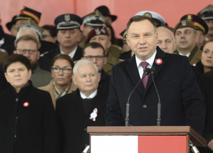Polish President Andrzej Duda, right, speaks during the official ceremony marking Poland's Independence Day, in Warsaw, Poland, Sunday, Nov. 11, 2018, as leader of the ruling Law and Justice party, Jaroslaw Kaczynski, second left, stands behind. The Independence Day in Poland celebrates the nation regaining its sovereignty at the end of World War I after being wiped off the map for more than a century. (AP Photo/Alik Keplicz)