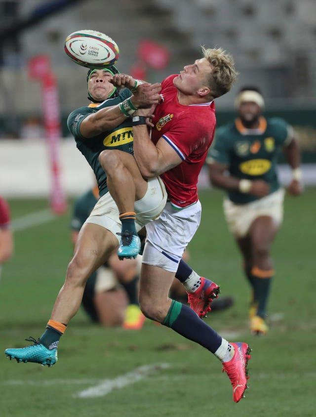 South Africa's Cheslin Kolbe (left) and British and Irish Lions' Duhan van der Merwe compete for a high ball in Cape Town