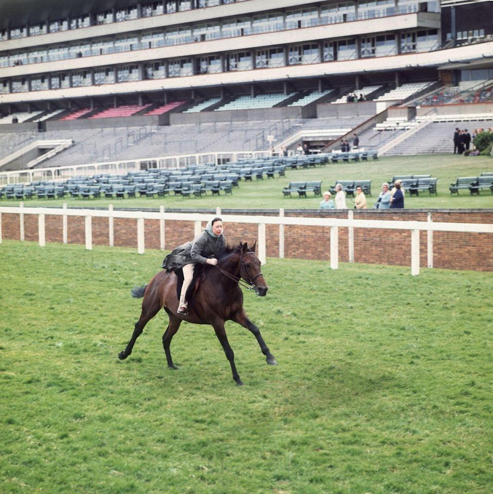 <p>Both Princess Margaret and Queen Elizabeth II grew up riding horses. Here is the princess racing at Ascot, earning her third-place finish. </p>
