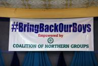 """A sign reading """"#BringBackOurBoys"""" is seen during a press conference organized by Coalition of Northern Groups following the abduction of hundreds of schoolboys, in Kankara"""