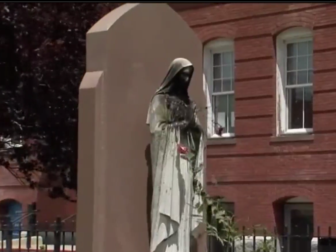 The vandalised statue of the Virgin Mary outside the Saint Peter's Parish church in Dorchester, Boston: (NBC10)