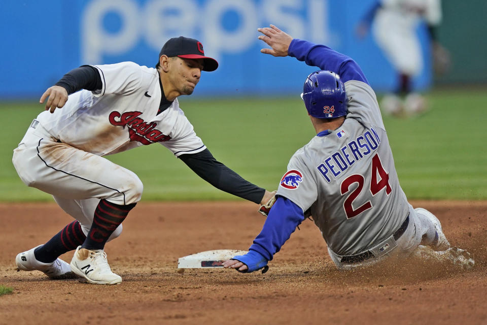 Cleveland Indians' Cesar Hernandez (7) tags out Chicago Cubs' Joc Pederson (24) after Pederson tried to steal to second base in the seventh inning of a baseball game, Tuesday, May 11, 2021, in Cleveland. (AP Photo/Tony Dejak)