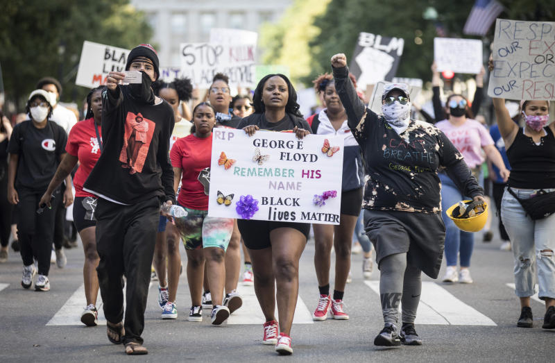 Protesters march in honor of George Floyd in downtown Raleigh, N.C., on Monday, the day a local LGBTQ bar owner says he was the subject of aggressive police tactics. (Julia Wall/The News & Observer via AP)