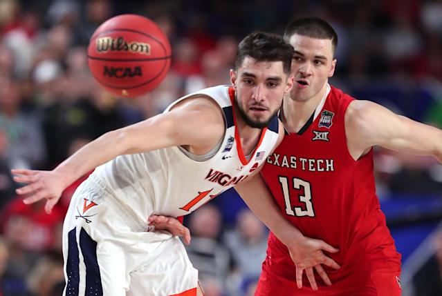 Ty Jerome #11 of the Virginia Cavaliers and Matt Mooney #13 of the Texas Tech Red Raiders battle for the ball in the second half during the 2019 NCAA men's Final Four National Championship game at U.S. Bank Stadium on April 08, 2019 in Minneapolis, Minnesota. (Photo by Tom Pennington/Getty Images)