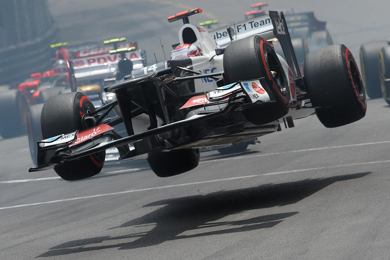 Sauber's Japanese driver Kamui Kobayashi crashes at the Circuit de Monaco on May 27, 2012 in Monte Carlo during the Monaco Formula One Grand Prix.    AFP PHOTO / TOM GANDOLFINITom Gandolfini/AFP/GettyImages