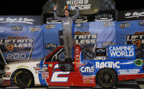 Sheldon Creed celebrates in Victory Lane after winning the NASCAR Truck Series auto race at Darlington Raceway, Friday, May 7, 2021, in Darlington, S.C. (AP Photo/Terry Renna)