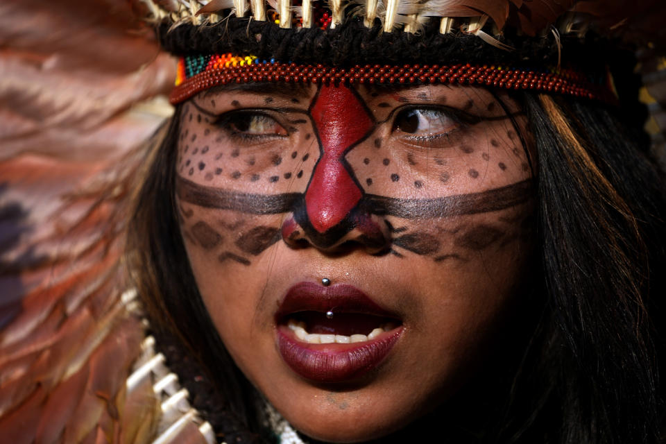 A protester takes part in an Indigenous women's march against the policies of President Jair Bolsonaro and in favor of women's rights and the demarcation of Indigenous lands in Brasilia, Brazil, Friday, Sept. 10, 2021. (AP Photo/Eraldo Peres)