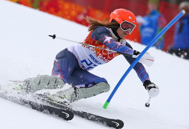 United States' Julia Mancuso passes a gate in the slalom portion of the women's supercombined to win the bronze medal in the Sochi 2014 Winter Olympics, Monday, Feb. 10, 2014, in Krasnaya Polyana, Russia.(AP Photo/Alessandro Trovati)