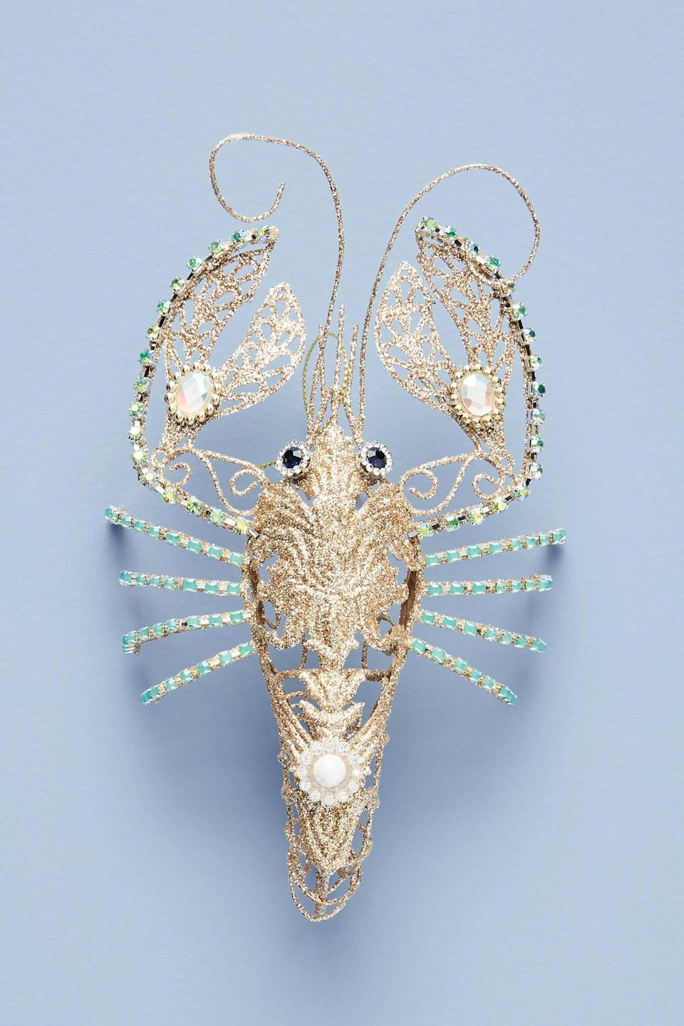 """<p>Add a touch of glamour and oceanic charm to your tree with the <a href=""""https://www.popsugar.com/buy/Embellished-Lobster-Ornament-490522?p_name=Embellished%20Lobster%20Ornament&retailer=anthropologie.com&pid=490522&price=28&evar1=casa%3Aus&evar9=46615300&evar98=https%3A%2F%2Fwww.popsugar.com%2Fhome%2Fphoto-gallery%2F46615300%2Fimage%2F46615392%2FEmbellished-Lobster-Ornament&list1=shopping%2Canthropologie%2Choliday%2Cchristmas%2Cchristmas%20decorations%2Choliday%20decor%2Chome%20shopping&prop13=mobile&pdata=1"""" rel=""""nofollow noopener"""" class=""""link rapid-noclick-resp"""" target=""""_blank"""" data-ylk=""""slk:Embellished Lobster Ornament"""">Embellished Lobster Ornament</a> ($28).</p>"""