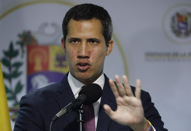 Venezuela's National Assembly President and self-proclaimed interim President Juan Guaido speaks to the press in Caracas, Venezuela, Monday, Sept. 16, 2019. A group of minority opposition parties in Venezuela agreed Monday to enter negotiations with President Nicolas Maduro's government without the consent of the U.S.-backed opposition leader. (AP Photo/Ariana Cubillos)