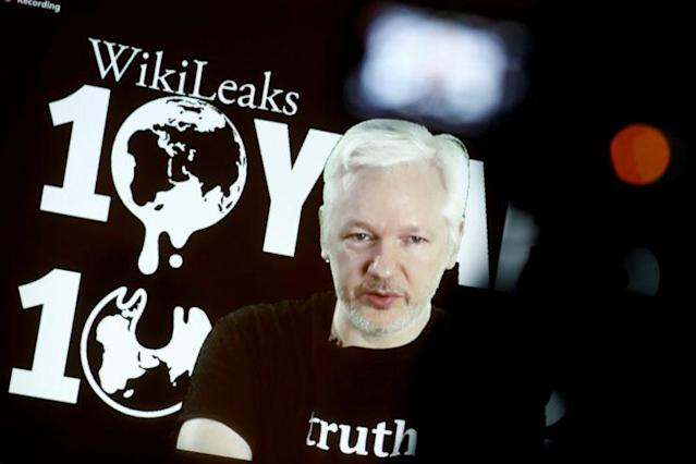Julian Assange, founder of WikiLeaks, speaks via video link during a press conference on the 10-year anniversary of the controversial organization. (Photo: Axel Schmidt/Reuters)
