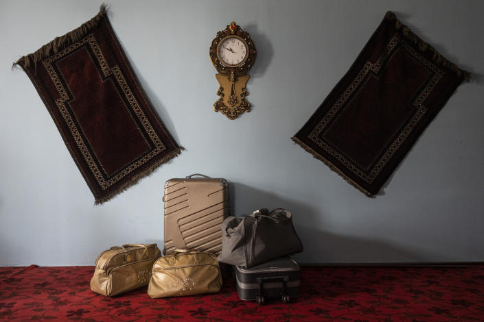 Travel bags from a family of Afghan musicians are packed and stored in a living room in Kabul, Afghanistan, Thursday, Sept. 23, 2021. Despite none of the family members having visas to travel outside Afghanistan, they have their bags packed while waiting for an opportunity to leave the country. (AP Photo/Bernat Armangue)
