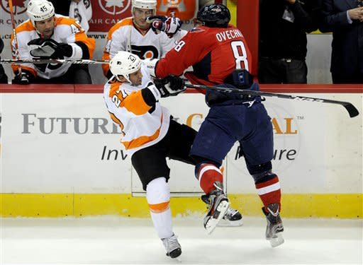 Philadelphia Flyers center Maxime Talbot (27) collides with Washington Capitals left wing Alex Ovechkin (8), of Russia, during the first period of an NHL hockey game, Tuesday, Dec. 13, 2011, in Washington. (AP Photo/Nick Wass)
