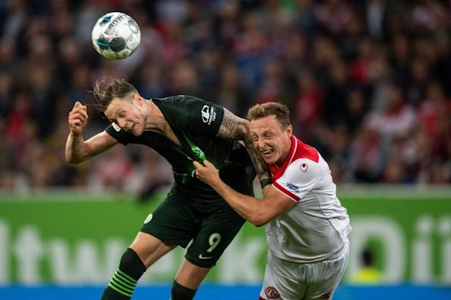 Wout Weghorst continued his scoring form for Wolfsburg in a 1-1 draw with Duesseldorf on Friday (AFP Photo/Marius Becker)