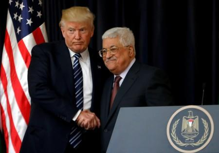 FILE PHOTO: U.S. President Donald Trump shakes hands with Palestinian President Mahmoud Abbas during a joint news conference at the presidential headquarters in the West Bank town of Bethlehem