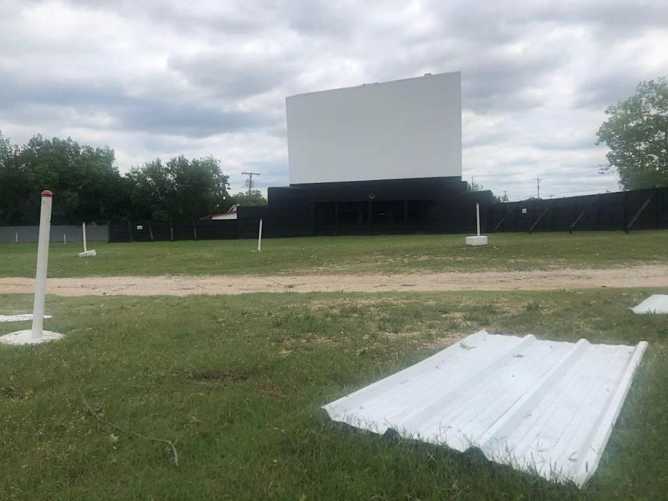 The Brazos Drive-In Theatre in Granbury is closed until further notice after a tornado tore up the property's fencing. The property's outdoor screen remains standing.