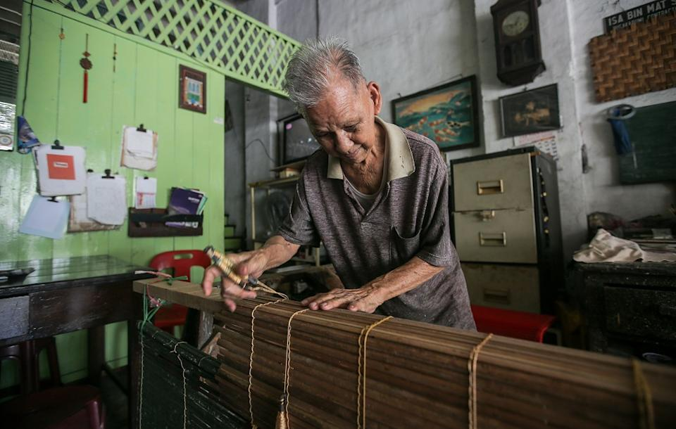 Chick blinds weaver Lau Chee Wah said he works from morning to night when an order comes in.
