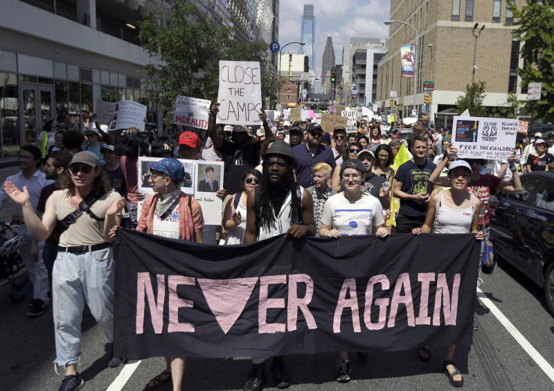 FILE - In this July 4, 2019, file photo, protesters assembled by a majority Jewish group called Never Again Is Now walk through traffic as they make their way to Independence Mall in Philadelphia. A fledgling coalition of liberal Jewish groups is increasingly making itself heard as it fights the Trump administration's immigration policies. (AP Photo/Jacqueline Larma, File)