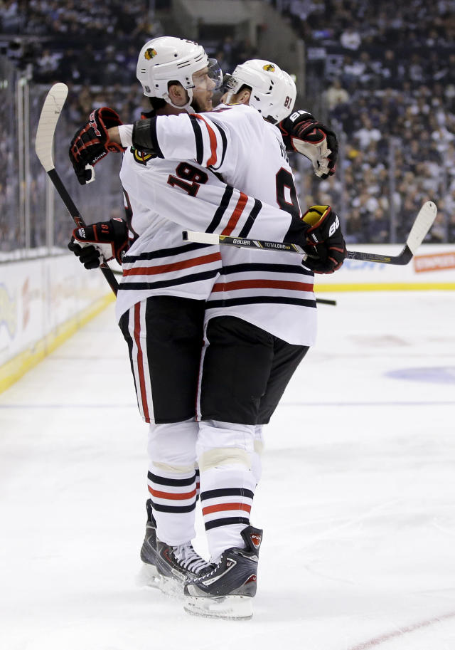 Chicago Blackhawks center Jonathan Toews, left, celebrates his goal against the Los Angeles Kings with right wing Marian Hossa during the first period of Game 3 of the Western Conference finals of the NHL hockey Stanley Cup playoffs in Los Angeles, Saturday, May 24, 2014. (AP Photo/Chris Carlson)