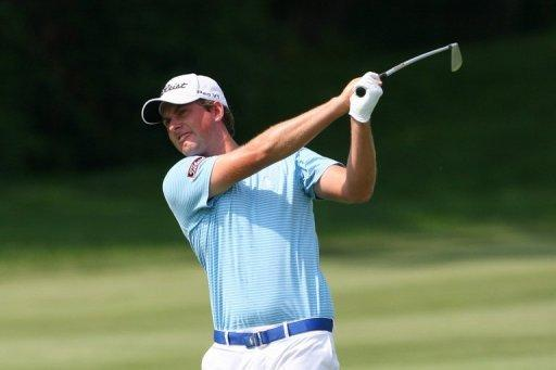 Webb Simpson hits his second shot on the 12th hole