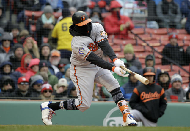 Baltimore Orioles' Manny Machado hits an RBI-double off a pitch by Boston Red Sox's Chris Sale in the first inning of a baseball game Sunday, April 15, 2018, in Boston. (AP Photo/Steven Senne)
