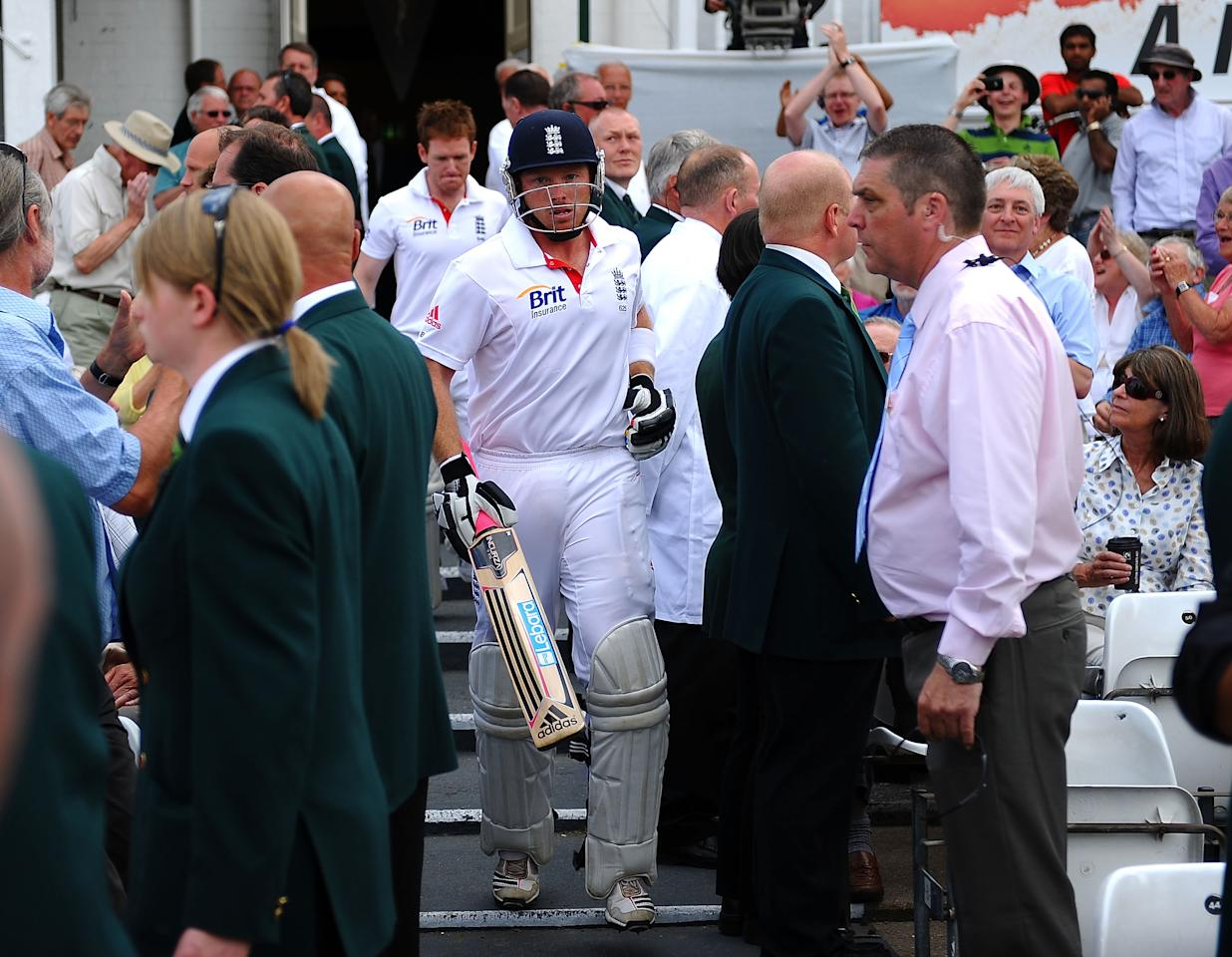 NOTTINGHAM, ENGLAND - JULY 31: Ian Bell of England emerges from tea after being re instated after being given run out on the stroke of tea during the second npower Test match between England and India at Trent Bridge on July 31, 2011 in Nottingham, England.  (Photo by Laurence Griffiths/Getty Images)