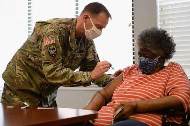 PHOTO: In this Feb. 11, 2021, file photo, Staff Sergeant Herbert Lins of the Missouri Army National Guard administers the Covid-19 vaccine to a resident during a vaccination event in St Louis, Missouri.  (Michael Thomas/Getty Images, FILE)