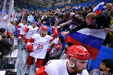 Feb 23, 2018; Gangneung, South Korea; Russia forward Mikhail Grigorenko (25) greets fans after defeating the Czech Republic the men's ice hockey semifinals during the Pyeongchang 2018 Olympic Winter Games at Gangneung Hockey Centre. Mandatory Credit: Andrew Nelles-USA TODAY Sports