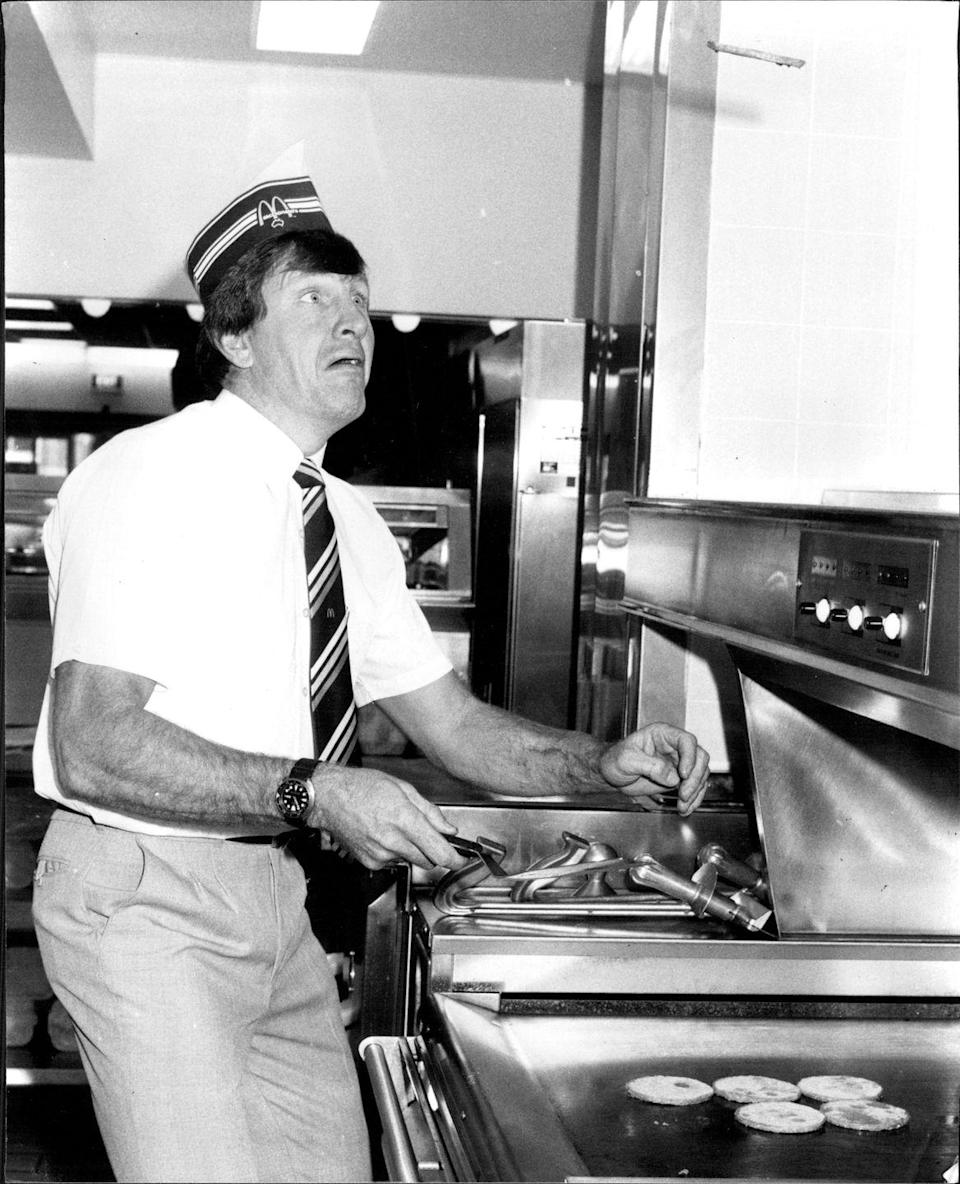 <p>Former rugby league player, Ron Coote, celebrated the opening of his McDonald's restaurant by flipping burgers in the back.</p>