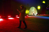 A man walks near a light sculpture before a New Year's Eve countdown event at the 2022 Beijing Winter Olympic headquarters in Bejiing, Tuesday, Dec. 31, 2019. Revelers around the globe are bidding farewell to a decade that will be remembered for the rise of social media, the Arab Spring, the #MeToo movement and, of course, President Donald Trump. (AP Photo/Ng Han Guan)
