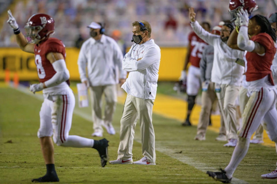 Alabama coach Nick Saban watches from the sideline during the second half of the team's NCAA college football game against LSU in Baton Rouge, La., Saturday, Dec. 5, 2020. (AP Photo/Matthew Hinton)