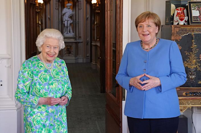 Britain's Queen Elizabeth II receives German Chancellor Angela Merkel during an audience at Windsor Castle in Windsor, Berkshire on July 2, 2021. - German leader Angela Merkel will have a new a science prize established in her honour during a farewell visit to Britain on Friday, which will also include a meeting with Queen Elizabeth II. (Photo by Steve Parsons / POOL / AFP) (Photo by STEVE PARSONS/POOL/AFP via Getty Images)