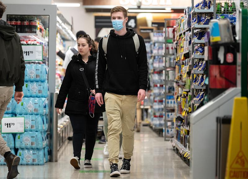 People are now recommended to wear masks inside supermarkets. Source: AAP