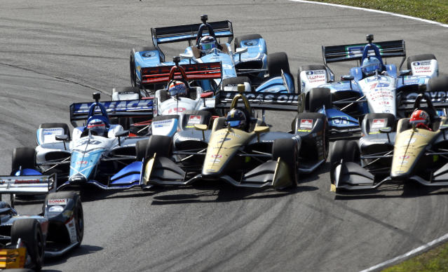 Marcus Ericsson (7) comes together with Takuma Sato (30) on the first lap during the IndyCar Series auto race, Sunday, July 28, 2019, at Mid-Ohio Sports Car Course in Lexington, OH. (AP Photo/Tom E. Puskar)