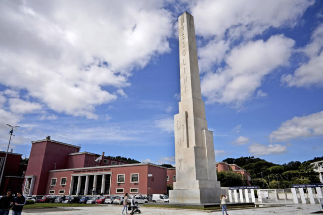 A marble obelisk by architect Costantino Costantini with writing reading in Latin MVSSOLINI DVX (Mussolini Leader) stands at the Foro Italico sporting complex, formerly called Foro Mussolini (Mussolini's Forum), in front of the Olympic Stadium, in Rome, Monday, May 6, 2019. It is one of the few public references to Mussolini which remained after WWII. The Foro was built under Mussolini's regime to bolster Rome's bid for the Olympics in the 1940's, the obelisk was built in 1932. (AP Photo/Andrew Medichini)