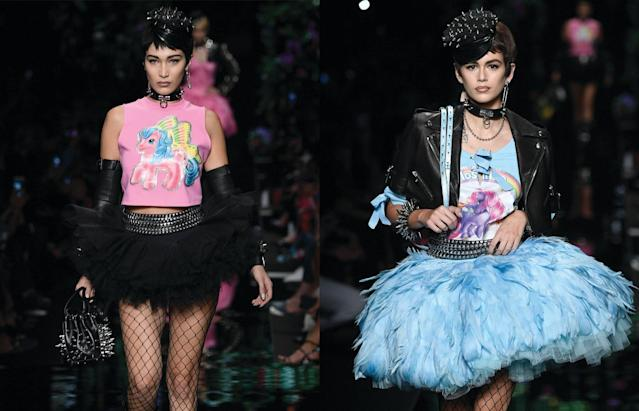 Bella Hadid, left, and Kaia Gerber walk the Moschino Spring 2018 fashion show in Milan. Their shirts are priced at $350 and $395, respectively. (Photo: Getty Images)