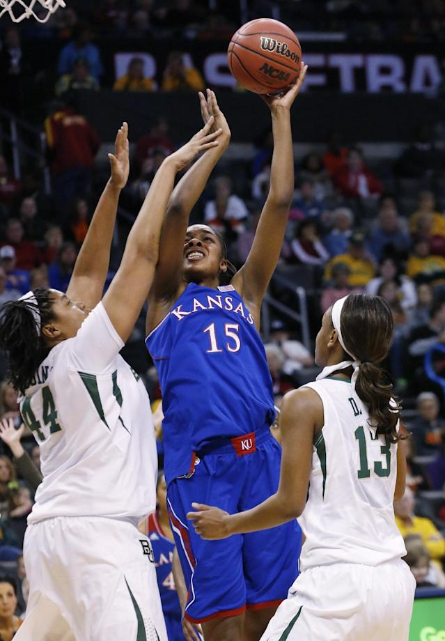 Kansas forward Chelsea Gardner (15) shoots between Baylor point Kristina Higgins (44) and forward Nina Davis (13) in the first half of an NCAA college basketball game in the quarterfinals of the Big 12 Conference women's college tournament in Oklahoma City, Saturday, March 8, 2014. Baylor won 81-47. (AP Photo/Sue Ogrocki)