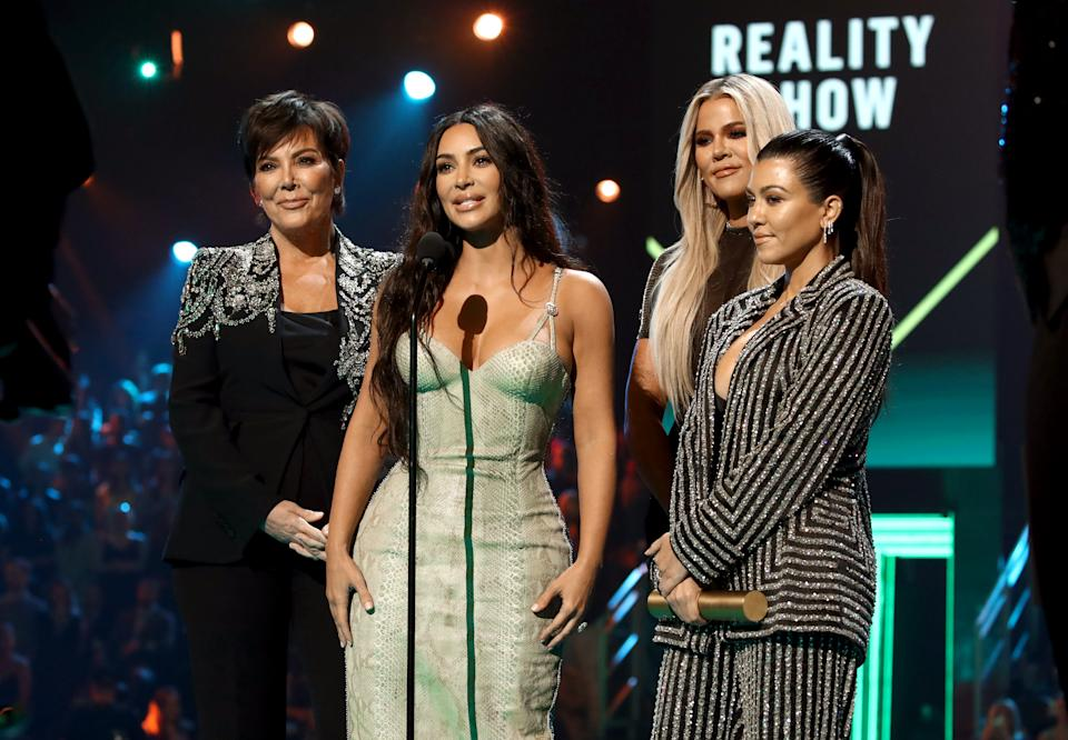 2019 E! PEOPLE'S CHOICE AWARDS -- Pictured: (l-r) Kris Jenner, Kim Kardashian, Khloé Kardashian, and Kourtney Kardashian accept The Reality Show of 2019 for 'Keeping Up with the Kardashians' on stage during the 2019 E! People's Choice Awards held at the Barker Hangar on November 10, 2019