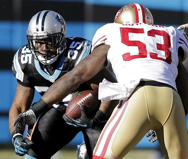 Carolina Panthers fullback Mike Tolbert (35) runs into San Francisco 49ers inside linebacker NaVorro Bowman (53) during the second half of a divisional playoff NFL football game, Sunday, Jan. 12, 2014, in Charlotte, N.C. (AP Photo/Chuck Burton)