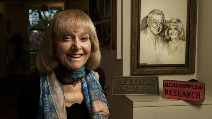 """Lillian Michelson, a retired film researcher, is photographed next to an artist's rendering of her and late husband Harold Michelson, a storyboard artist/production designer, on the wall in front of her apartment in Woodland Hills in 2017. <span class=""""copyright"""">(Mel Melcon / Los Angeles Times)</span>"""