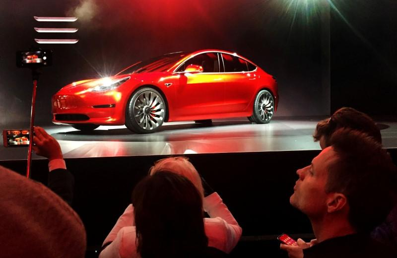 FILE PHOTO: A Tesla Model 3 sedan, its first car aimed at the mass market, is displayed during its launch in Hawthorne, California, U.S. March 31, 2016. REUTERS/Joe White/File Photo