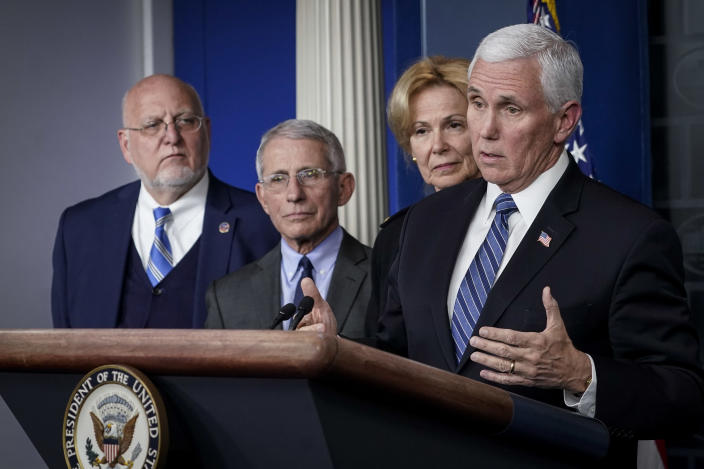 Vice President Mike Pence speaks at a press briefing on the coronavirus Monday at the White House. Standing with him, from left: Robert Redfield, director of the CDC; Dr. Anthony Fauci, director of the National Institute of Allergy and Infectious Diseases; and Deborah Birx, White House coronavirus response coordinator. (Drew Angerer/Getty Images)