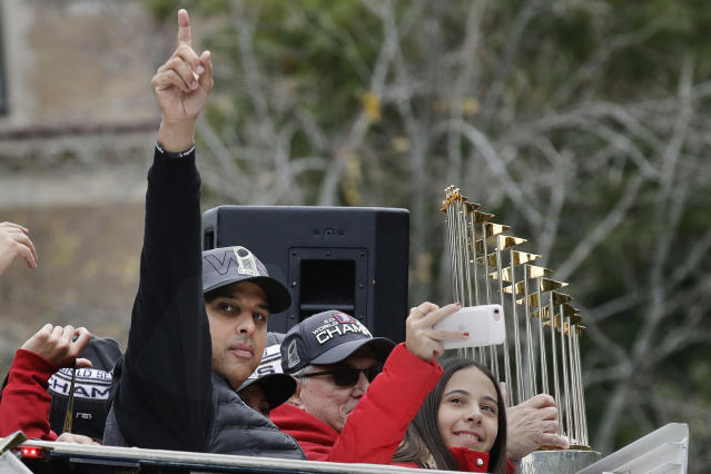 FILE— In this Oct. 31, 2018, file photo, Boston Red Sox manager Alex Cora rides with the trophy during a parade in Boston to celebrate the team's World Series championship over the Los Angeles Dodgers. Cora was fired by the Red Sox on Tuesday, Jan. 14, 2020, a day after baseball Commissioner Rob Manfred implicated him in the sport's sign-stealing scandal. (AP Photo/Charles Krupa, File)