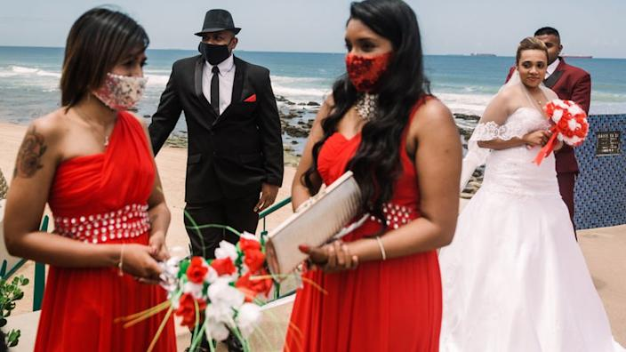 A wedding group seen by the beach in Durban, South Africa - 9 December 2020