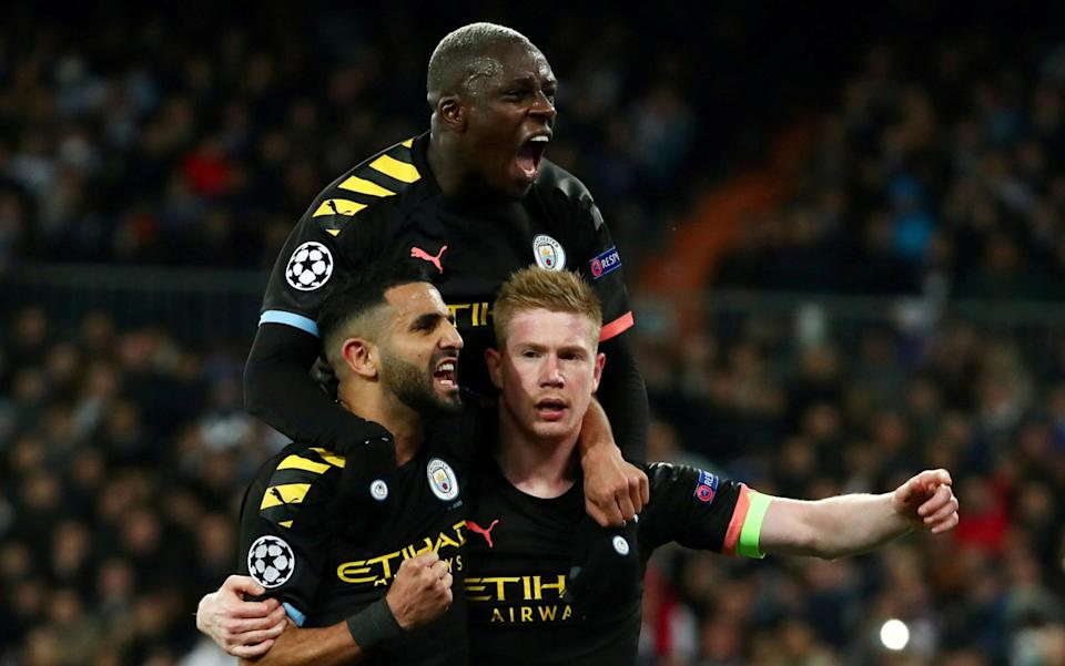 Manchester City's Kevin De Bruyne celebrates scoring their second goal with Riyad Mahrez and Benjamin Mendy - Reuters