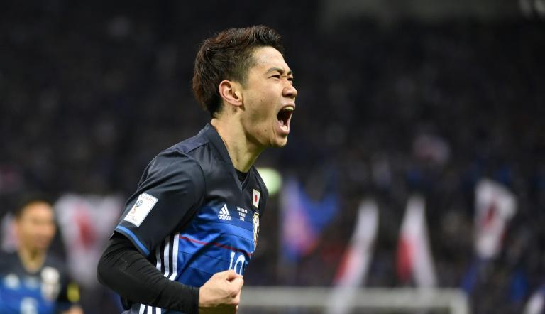 Japan's Shinji Kagawa celebrates scoring against Thailand in a World Cup qualifier in Saitama on March 28, 2017